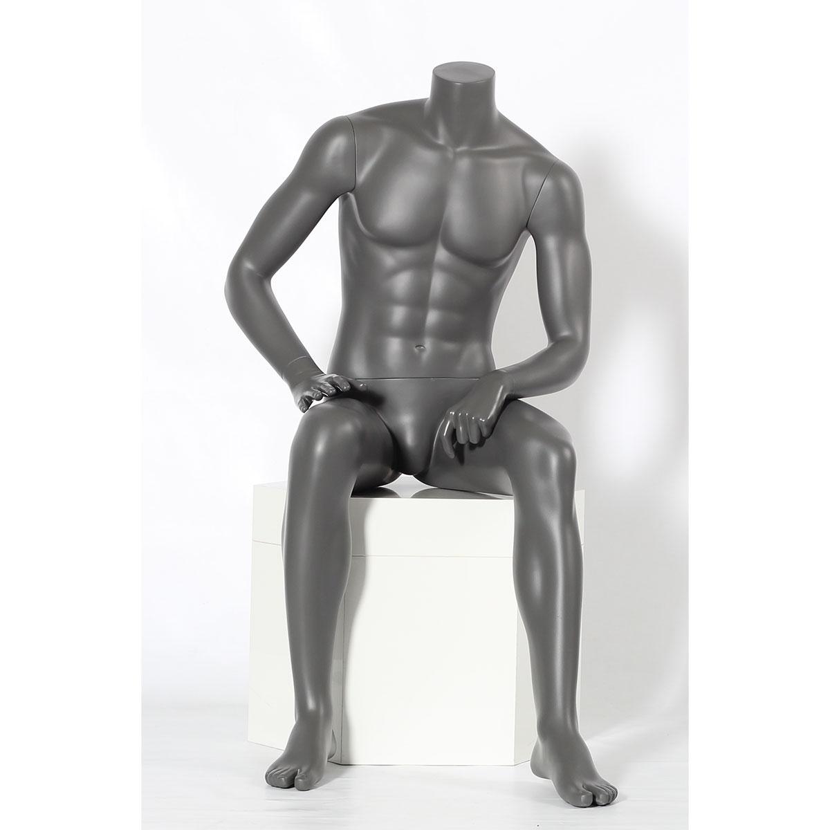 Sitzende Schaufensterpuppe Mann